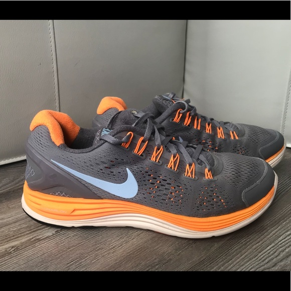 the latest 024b4 c133b NIKE Lunarglide 4 Women Size 9.5 Orange Gray Blue.  M 5ba88b27f63eea9165e5f297